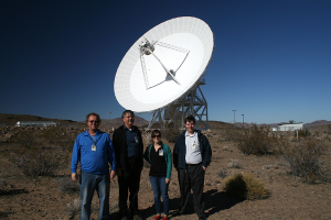 OSIRIS-REx team members standing in front of Deep Space Station 22 – one the 34-m Beam Waveguide Antennas at the Goldstone DSN complex.