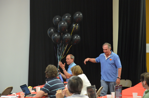 Jonathan presents Dave with a black-balloon bouquet - to celebrate his 50th birthday