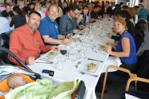 Steve Chesley and Bill Bottke (left) enjoy the ACM banquet offerings.