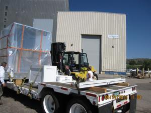 A good old forklift is used to load and unload the spacecraft from the transport.