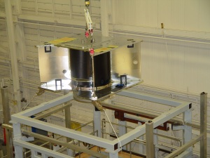 The static test fixture is a series of vices, which push and pull on the structure to simulate the loads that the spacecraft will experience during launch.