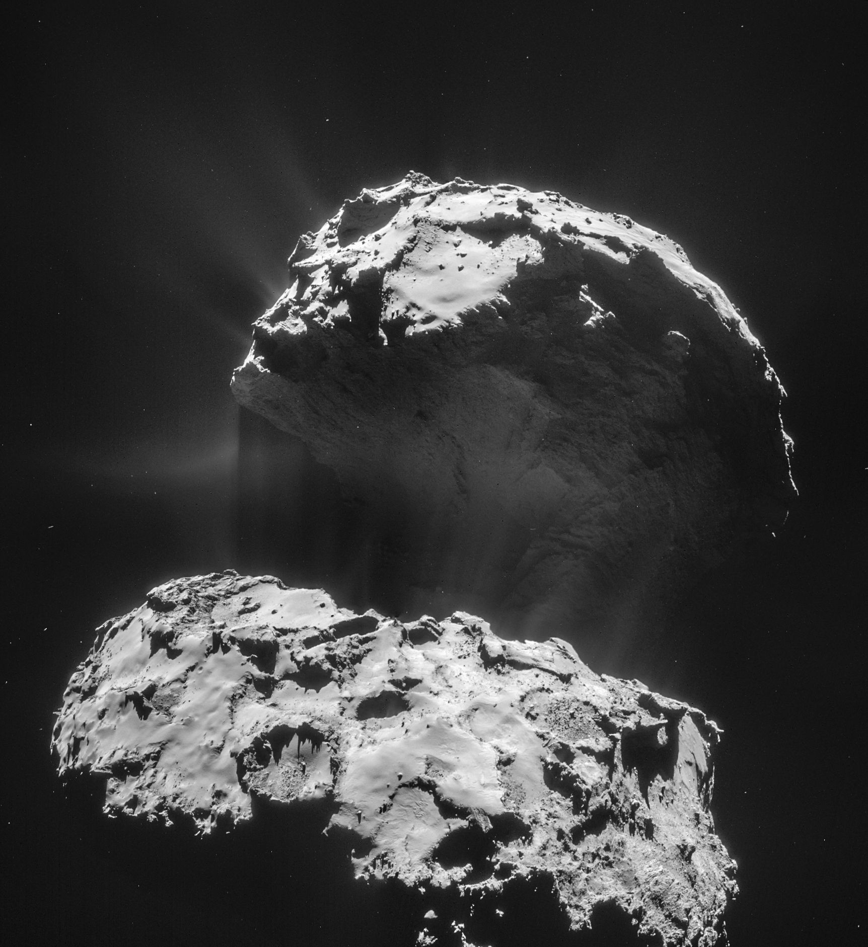 67P is truly an alien world, a 5 km-wide solar system body shaped by vaporizing ices and left tattered by its many trips around the Sun. (Credit ESA)
