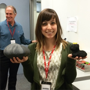 Coralie Jackman, an optical navigation specialist for the OSIRIS-REx team poses with two models of comet 67P/ Churyumov-Gerasimenko during the team's visit to Darmstadt. On the left is a model derived from ground-based optical observations of the comet. The more complex and challenging shape Rosetta discovered is on the right. (Credit Coralie Jackman)