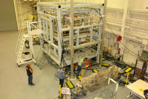 Assembly of OSIRIS-REx started with completion of the spacecraft structure - shown here in the static test fixture in September 2014.