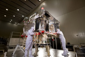 In a clean room facility near Denver, Lockheed Martin technicians continue assembling NASA's OSIRIS-Rex spacecraft that will collect samples of an asteroid.