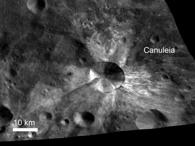 In this image from NASA's Dawn spacecraft, bright material extends out from the crater Canuleia on Vesta. This image was obtained by Dawn's framing camera on Oct. 25, 2011. Credit: NASA/JPL-Caltech/UCLA/MPS/DLR/IDA/UMD