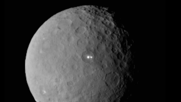 The bright spots on Ceres occur at the bottom of fresh impact craters - suggesting an icy subsurface layer.  Image: NASA/JPL-Caltech/UCLA/MPS/DLR/IDA