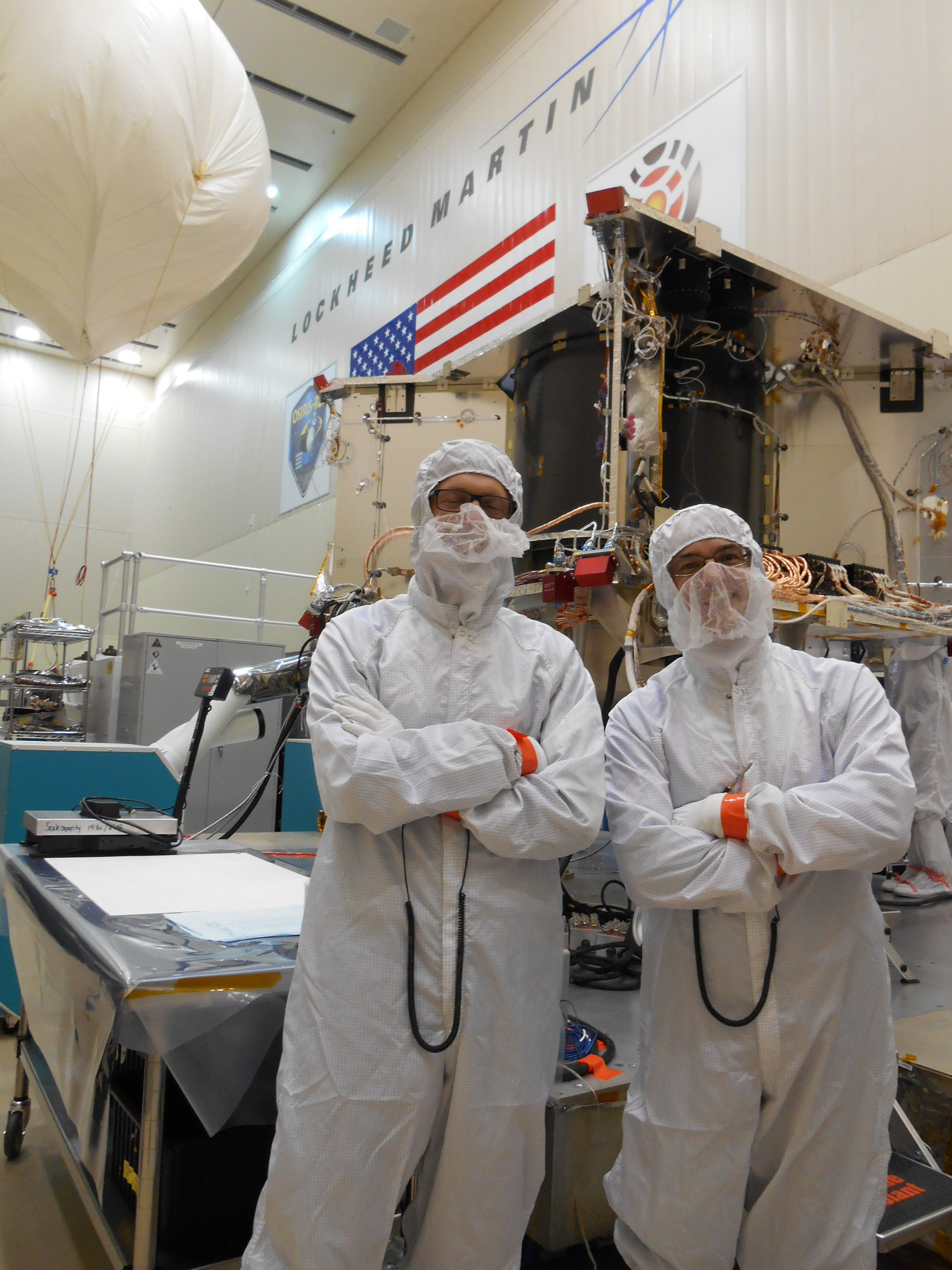 Kevin Walsh (left) and I pose for a shot with OSIRIS-REx in the background.
