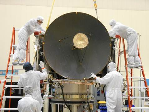 Here, the HGA undergoes a fit check. The main spacecraft structure is behind the HGA and the clean room engineers are checking the alignment where the HGA will be installed onto the spacecraft. Image Credit: Lockheed Martin