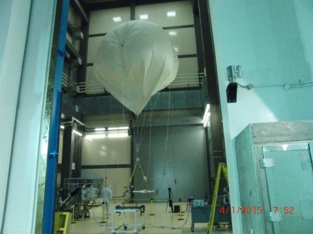 The TAGSAM instrument undergoing functional testing which tested its movement while a helium balloon was attached to it to simulate a microgravity environment. Image Credit: Lockheed Martin