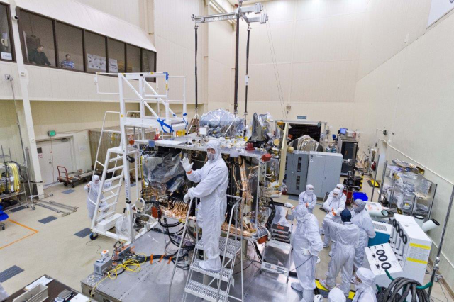 The SARA panel, containing both TAGSAM and the SRC was installed on the OSIRIS-REx spacecraft this month. Note the harnesses dropping the panel in. The SRC and TAGSAM are bagged to maintain cleanliness and ensure return of a pristine sample.